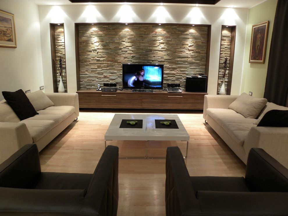 Do I Need a Boxspring for a Contemporary Living Room with a Stone Wall and Contemporary Living Room by Qinteriordesign.rs