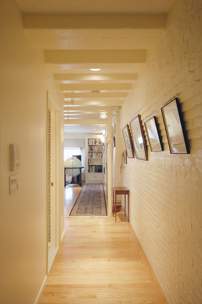 Do You Need a Boxspring for a Rustic Hall with a Gallery Wall and Boston Condo by Leslie Saul & Associates