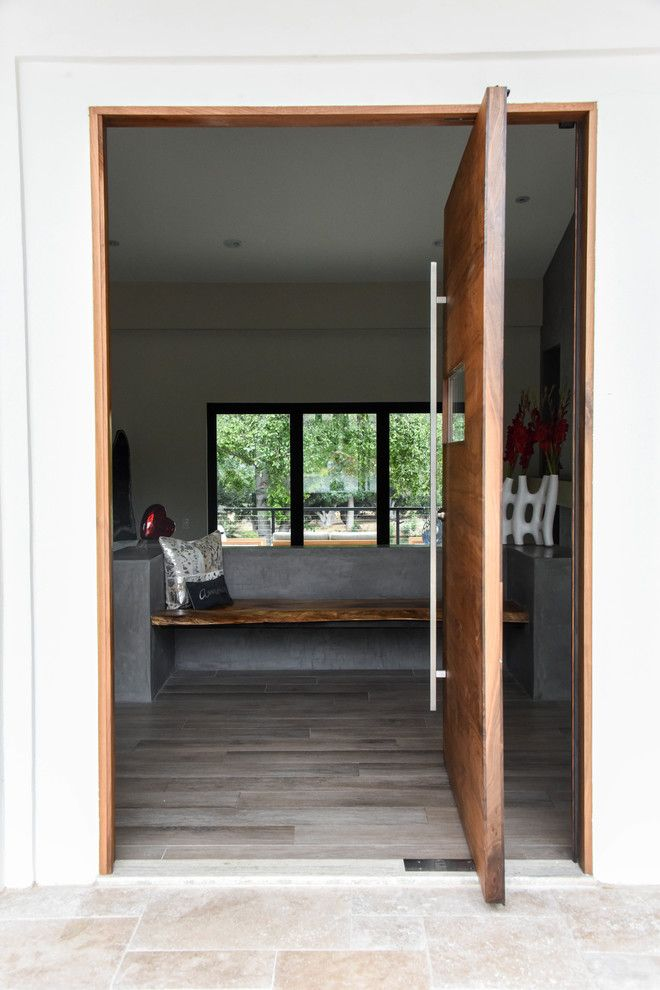 Door Jambs for a Modern Spaces with a Entrance Doors and the Wave Pivot Door in LA County by Fenstermann LLC