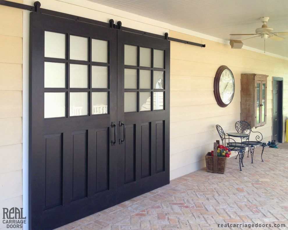 Door Jambs for a Traditional Patio with a Sliding Hardware and Exterior Sliding Barn Doors by Real Carriage Door Company