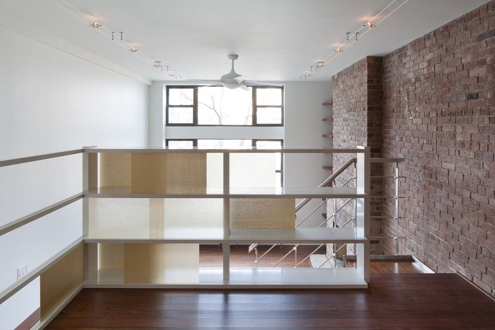 Dr Energy Saver for a Modern Staircase with a Built in Shelves and Greenwich Loft Studio by the Turett Collaborative