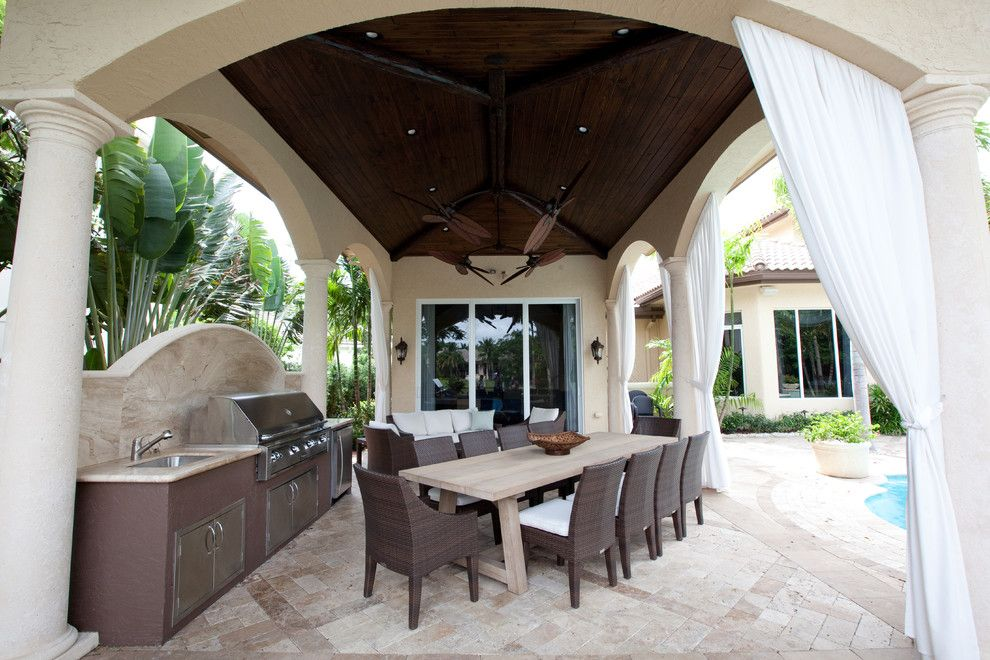 Drakes Landing for a Tropical Patio with a Covered Patio and Hawks Landing by Complete Home Improvement Group Inc.