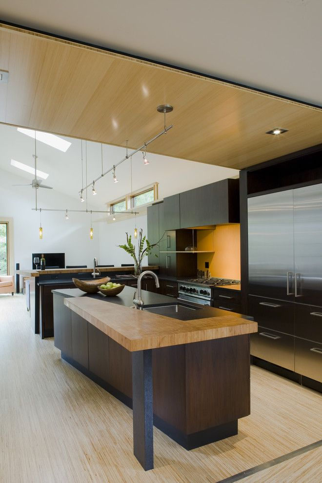 Drywall Textures for a Contemporary Kitchen with a Bamboo Floor and Fifties Split by Gardner Architects Llc