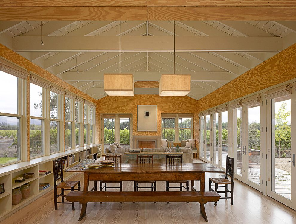 Eagle Roofing for a Farmhouse Dining Room with a Rustic Table and West Dry Creek Residence by Nick Noyes Architecture