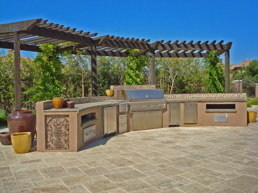 Eagle Roofing for a Mediterranean Patio with a Arbor and Mediterranean Patio by Houzz.com