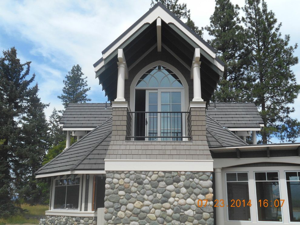 Eagle Roofing for a Transitional Exterior with a Medium Wood Entry Door and Master Suite Addition by Eaglepointe Construction & Management