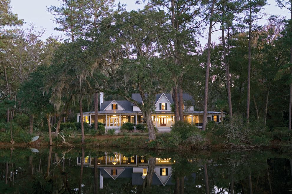 Earth Sheltered Homes for a Tropical Exterior with a Black and White and Carpenter Gothic Cottage | Spring Island, South Carolina by Historical Concepts