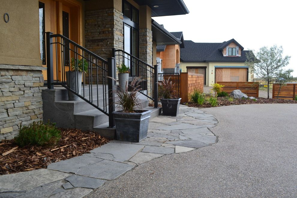 Earthled for a Traditional Landscape with a Flagstone Walkway and T/m Residence by Earthlings Inc.