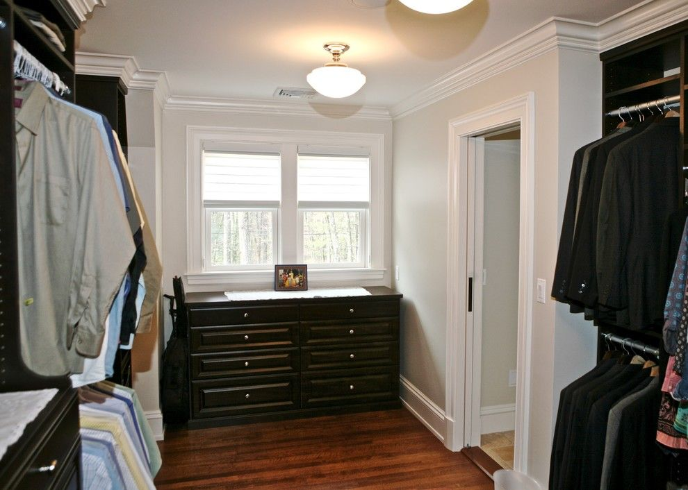 Eclipse Window Tinting for a Traditional Closet with a Walk in Closet and Dark Wood Master Walk in Suite by Marie Newton, Closets Redefined
