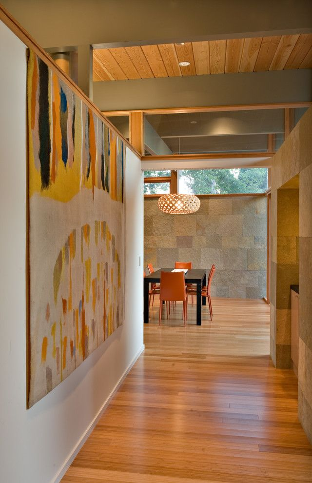 Eichler House for a Midcentury Hall with a Large Artwork and Quince Reverse Shed Eichler by Guy Ayers, Architect