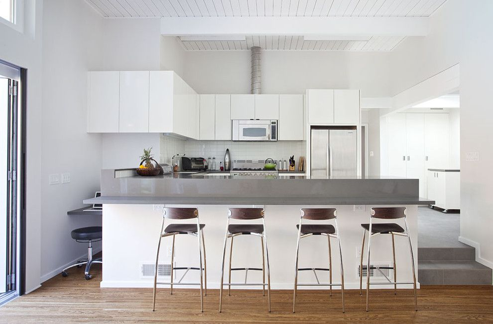 Eichler House for a Midcentury Kitchen with a Kitchen Island and Kitchen From Family Room by Klopf Architecture