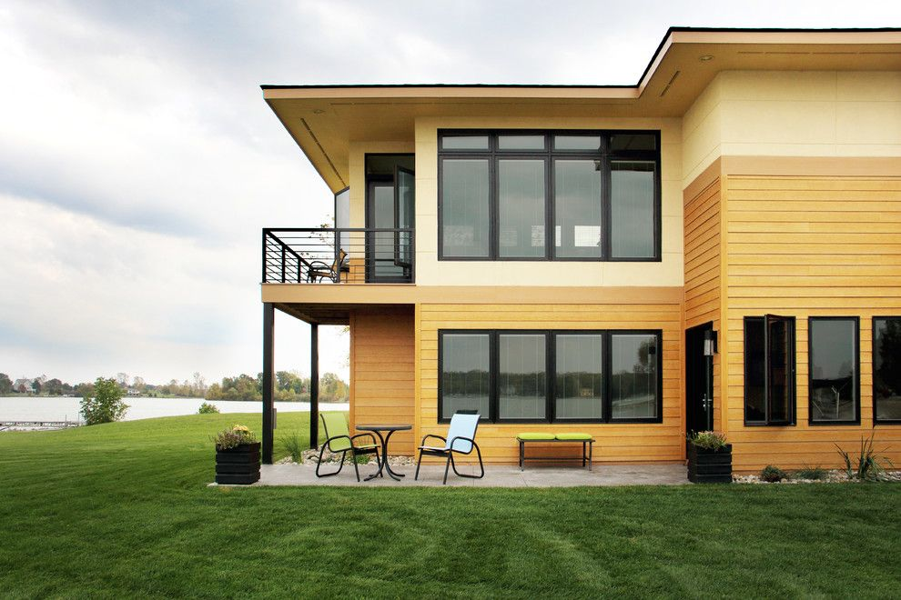 Eifs Siding for a Contemporary Spaces with a Patio and Exteriors by M R Builder Inc