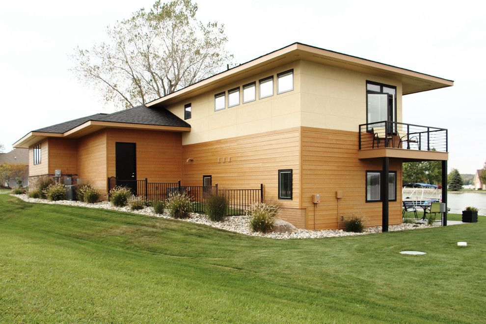 Eifs Siding for a Contemporary Spaces with a Steel and Exteriors by M R Builder Inc
