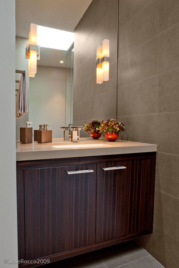 Electric Company Cast for a Contemporary Bathroom with a Wall Sconce Lights and Modern Ebony and Pewter Powder Room by Jennifer Gustafson Interior Design