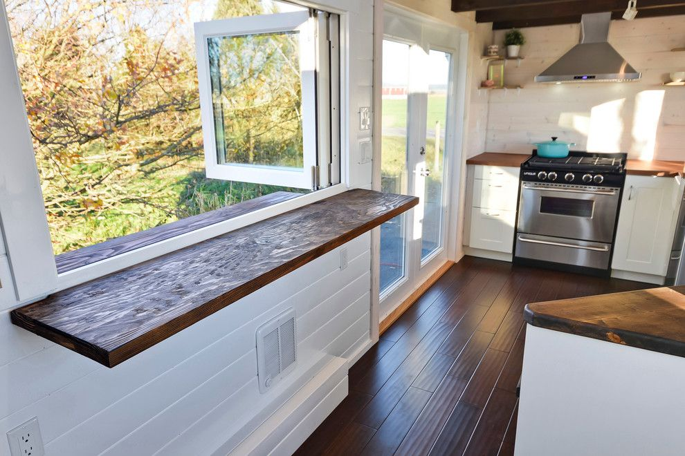 Electric Company Cast for a Farmhouse Spaces with a Farmhouse and Custom Tiny Home by Mint Tiny House Company