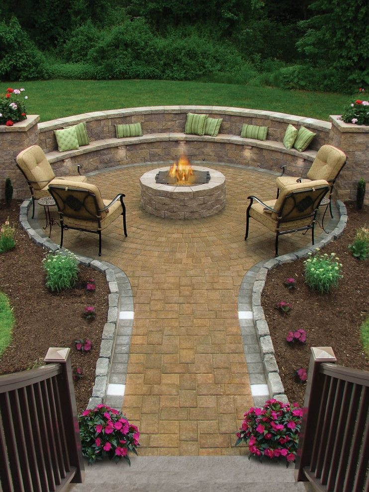 Electric Company Cast for a Traditional Patio with a Green Throw Pillows and Fire Pit by Conklin Limestone