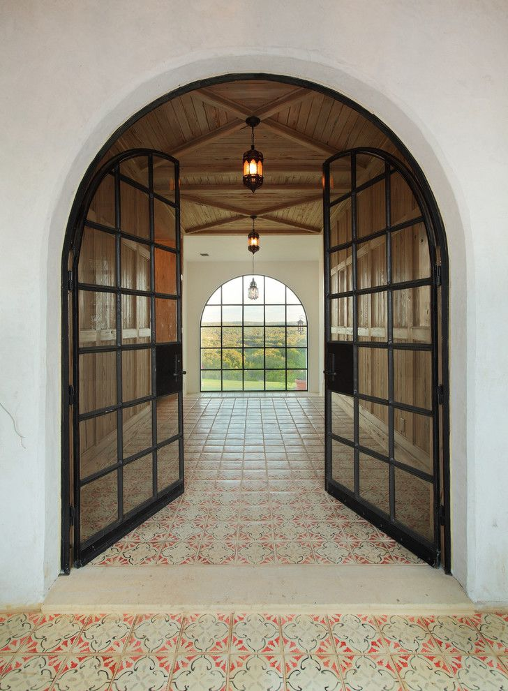 Emkay for a Rustic Entry with a Caustic Tile and Entry Foyer by Hugh Jefferson Randolph Architects