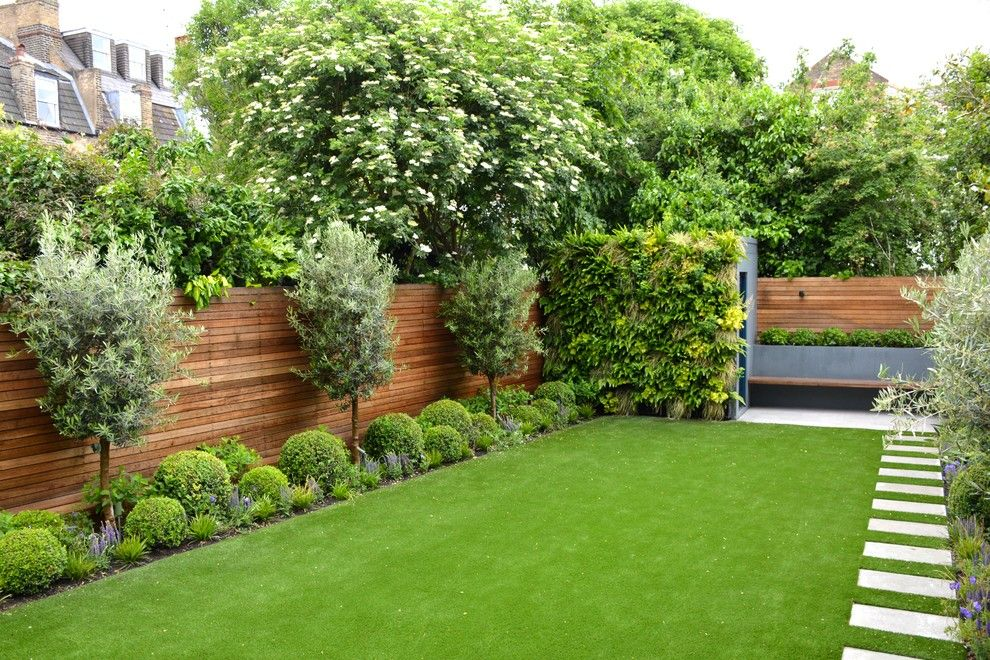 Espalier Fruit Trees for a Contemporary Landscape with a Wooden Fence and Fulham Garden by Tom Howard Garden Design and Landscaping