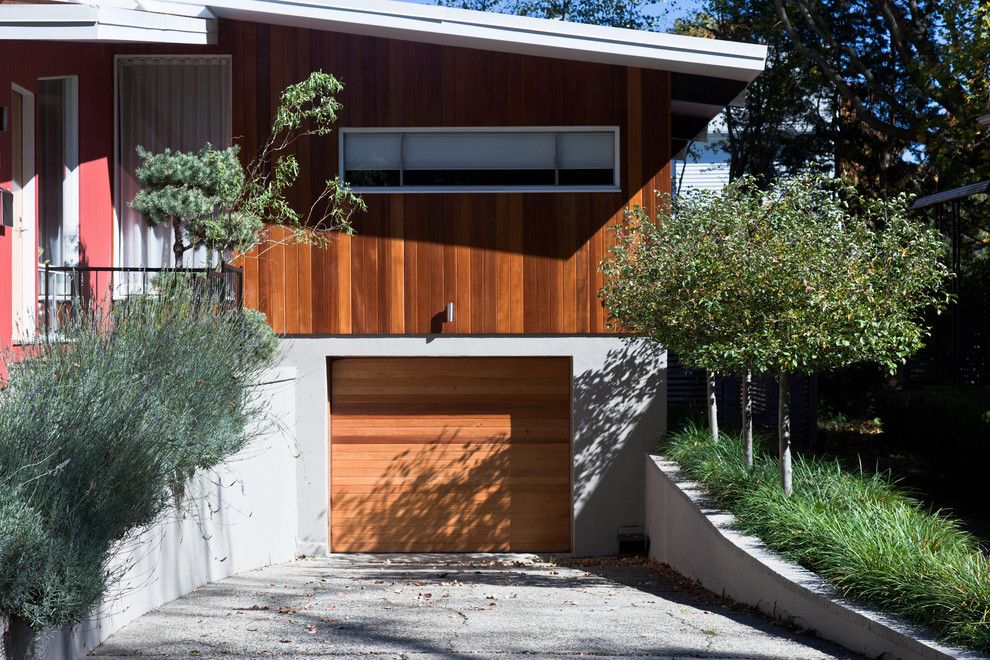 Espalier Fruit Trees for a Modern Garage with a Wood Siding and Hastings Lane by Matthew Cunningham Landscape Design Llc