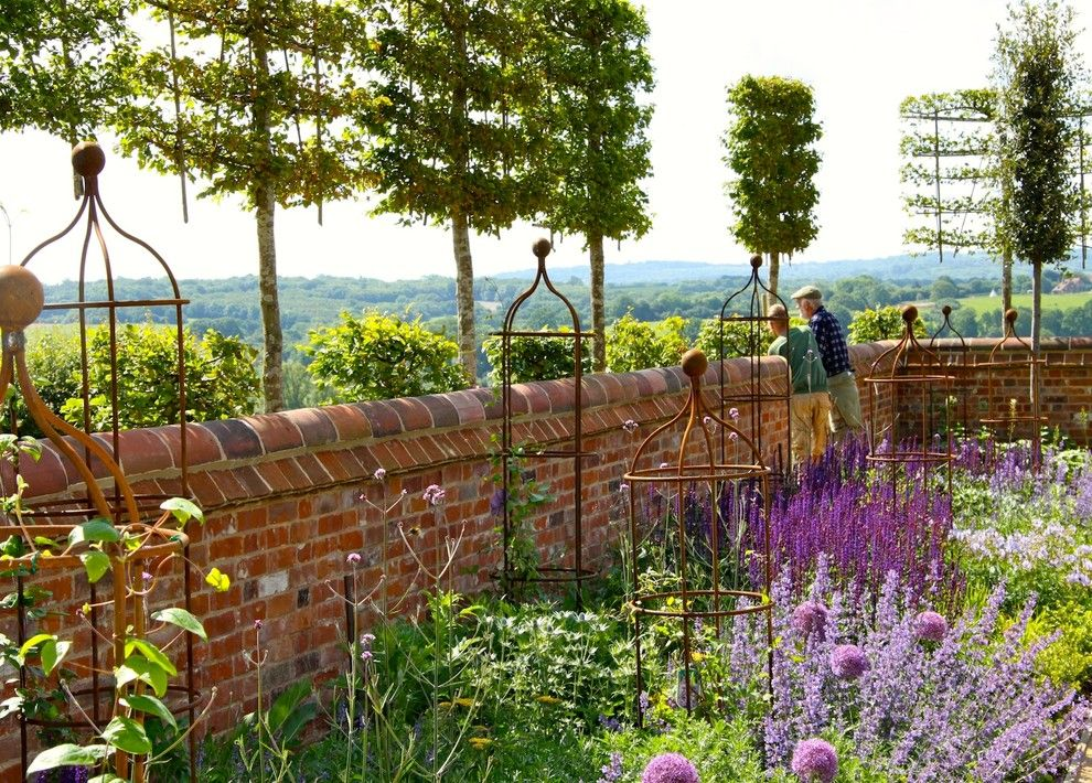 Espalier Fruit Trees for a Traditional Landscape with a Allium and Brede Valley by Marian Boswall Landscape Architects