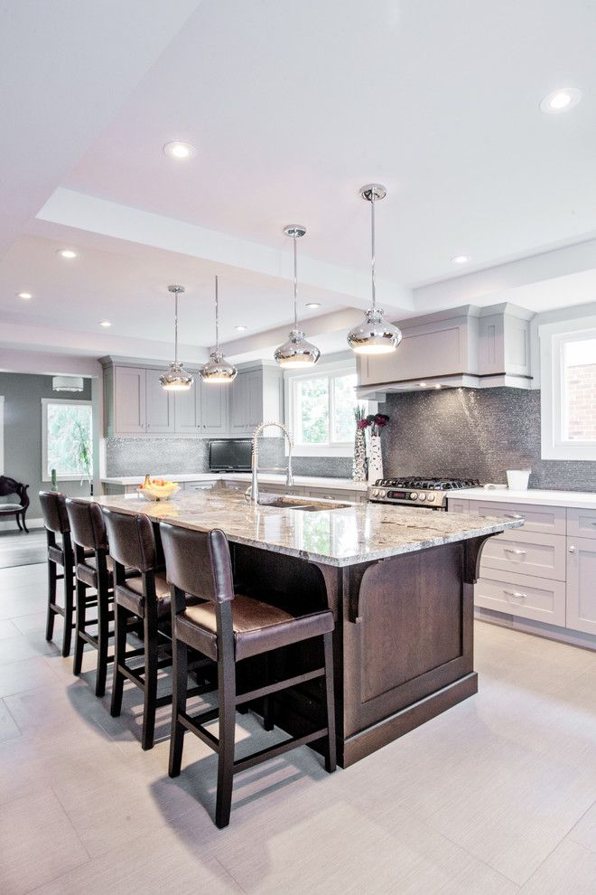 Espreso for a Transitional Kitchen with a Dark Wood Kitchen Island and Toronto Main Floor Home Renovation by Madison Taylor