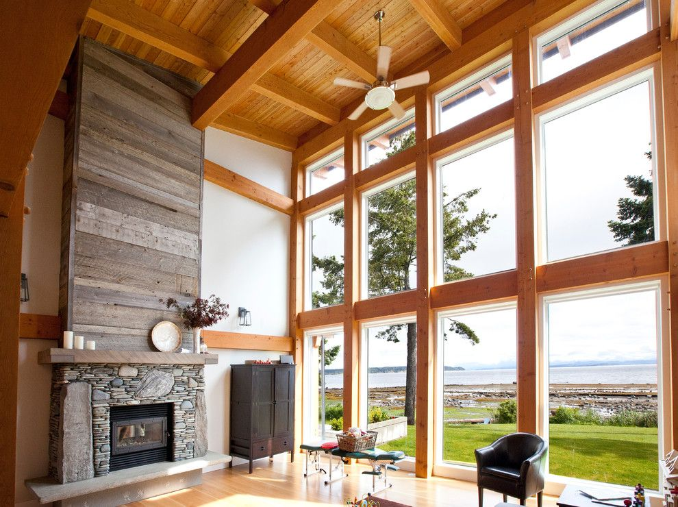 Everlast Roofing for a Contemporary Living Room with a Post and Beam and Timber Frame Great Room by Island Timberframe Ltd.