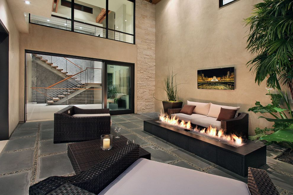 Everlast Roofing for a Contemporary Patio with a Wicker Furniture and Snug Harbor by Brandon Architects, Inc.