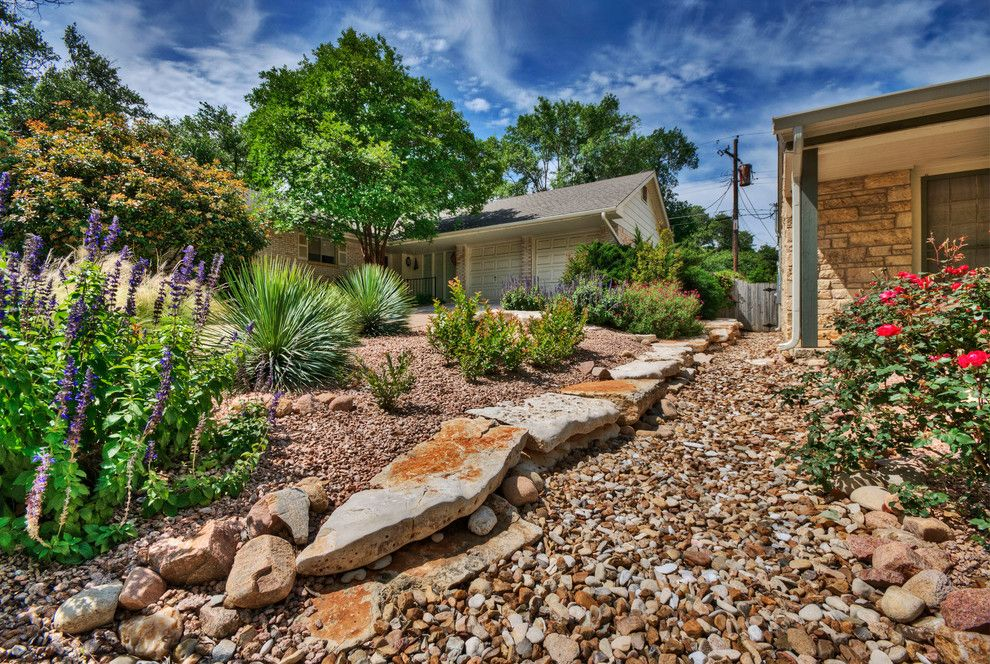 Ewing Irrigation for a Traditional Landscape with a Boulders and Project Five by Pearson Landscape Services