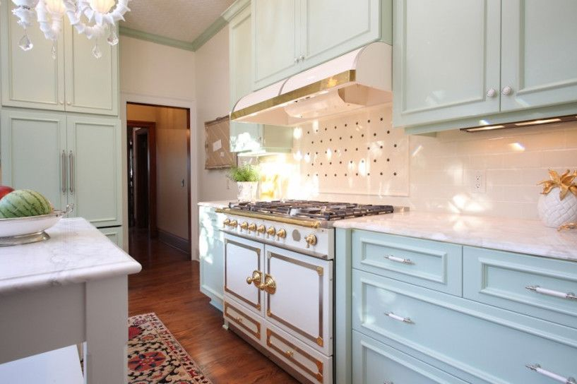 Excalibur Homes for a Traditional Kitchen with a Rug and Kitchen Range by Garrison Hullinger Interior Design Inc.