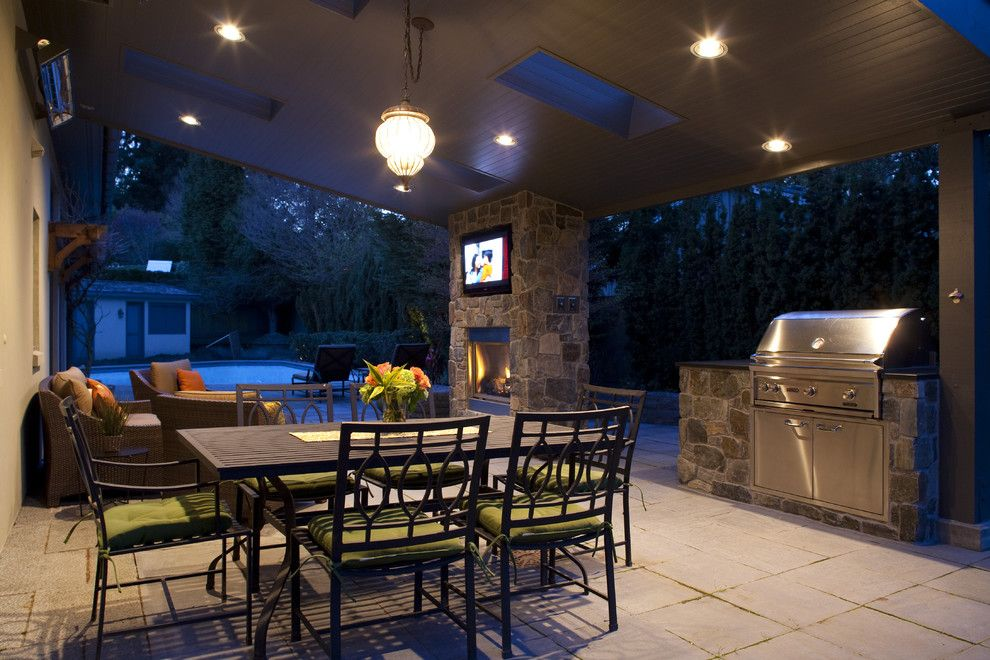 Excalibur Homes for a Traditional Patio with a Exterior Tv and Windermere Outdoor Room by Lakeville Homes