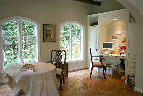 Eyebrow Arch for a Mediterranean Home Office with a Open Shelf Desk and Tuscan Treasure by Bowers Design Build