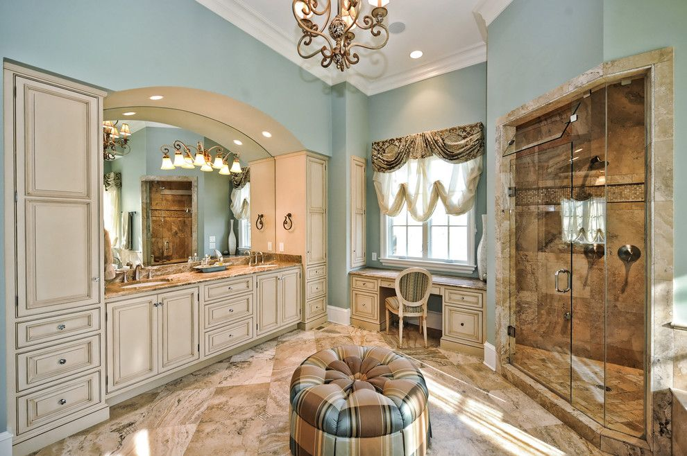 Fabric Stores Charlotte Nc for a Traditional Bathroom with a Beige Stone Floor and English Tudor by Benham Builders