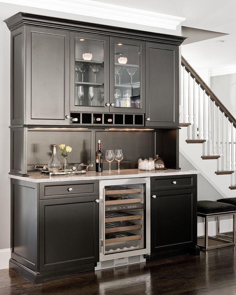 Factory Direct Tulsa for a Traditional Home Bar with a Glass Front Cabinets and Needham Bar by Venegas and Company