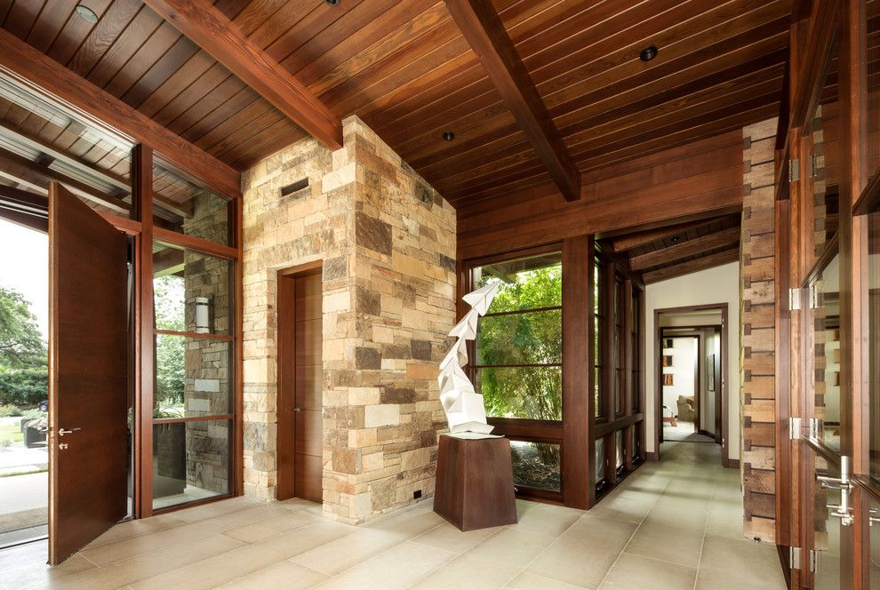 Famous Contemporary Artists for a Rustic Entry with a Beige Stone and Tarryhill Place by Ryan Street & Associates