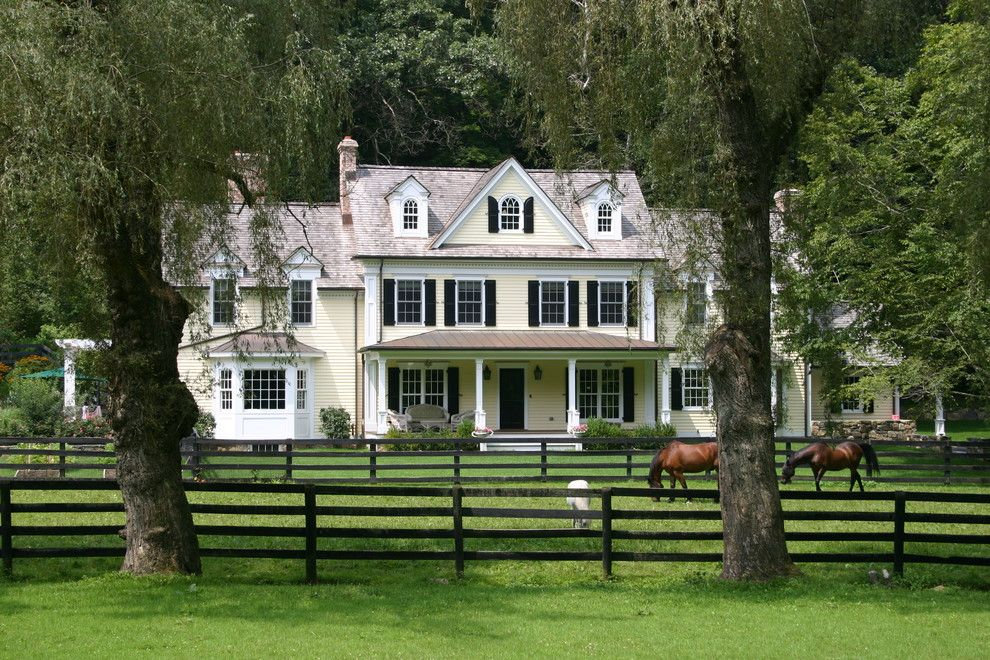 Fannin Tree Farm for a Farmhouse Exterior with a White Trim and Bedford Horse Farm by Cusato Management Corp.