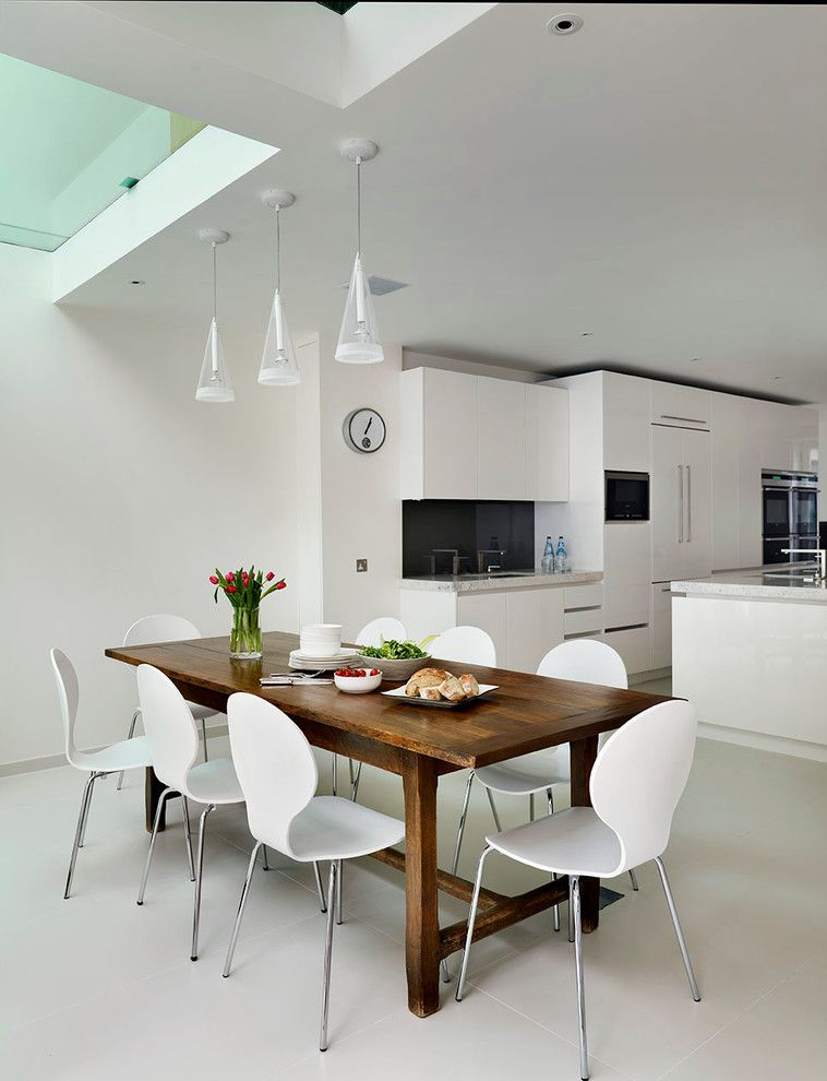 Farm Table Sf for a Contemporary Dining Room with a Rustic Wood Dining Table and Roundhouse White Kitchens by Roundhouse