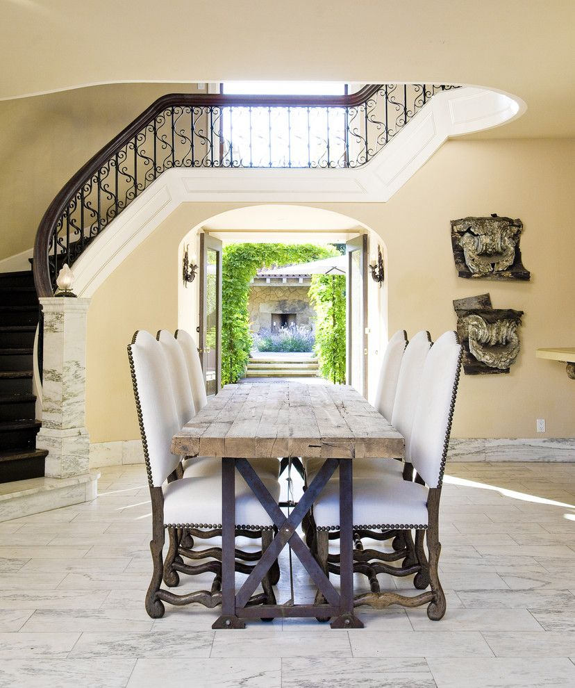Farm Table Sf for a Mediterranean Dining Room with a Dining Table and Entry/dining by Lori Smyth Design