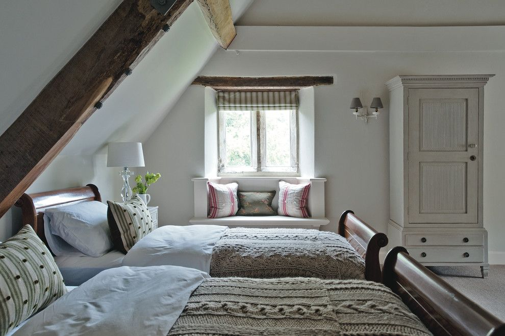 Farmgirl Flowers for a Farmhouse Bedroom with a Exposed Beams and Dorset Manor House by Sims Hilditch