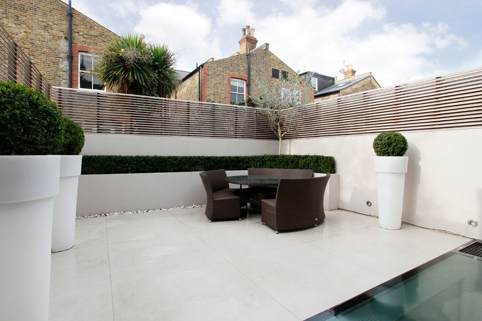 Fenceworks for a Contemporary Patio with a Paved Patio and Contemporary Patio by Veronicacongdondesign.co.uk