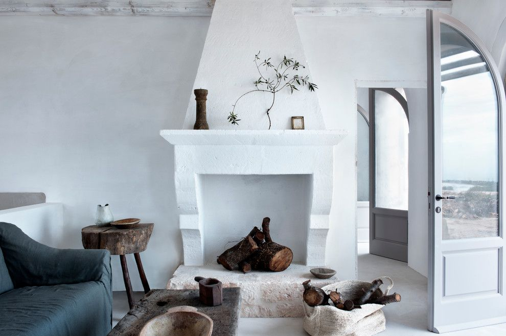 Fireplace Fashions for a Mediterranean Living Room with a White Living Room and Masseria Petrarolo Italy by Alexander Waterworth Interiors Ltd