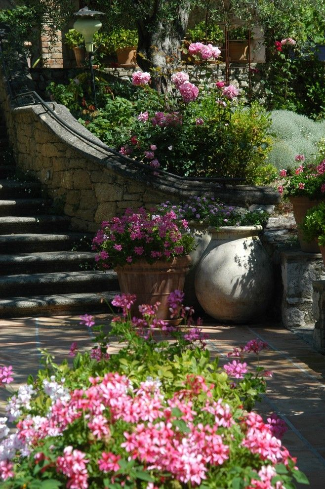 Flowerama for a Mediterranean Landscape with a Jardin Arbor and Provençal Garden by Atelier Nelumbo Garden Design
