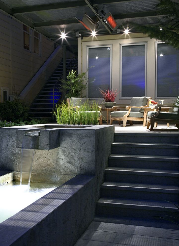 Fontana Theater for a Contemporary Patio with a Deck and Nightscape by Arterra Landscape Architects