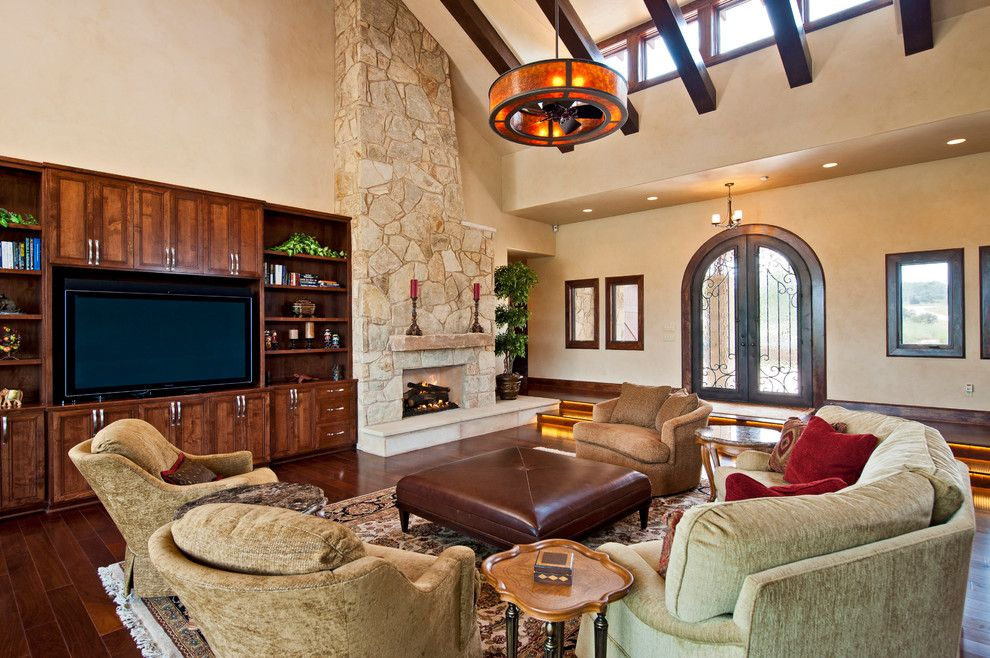 Fox Hills Golf Course for a Mediterranean Family Room with a Fireplace and Tuscan Custom Home on Golf Course by Jenkins Custom Homes