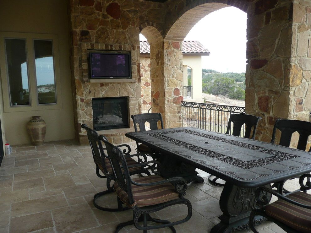Fox Hills Golf Course for a Mediterranean Patio with a Natural Stone Fireplace with Television and 3850 Pawnee Pass, Overlook of Flintrock by Canyon Creek Homes, Lp