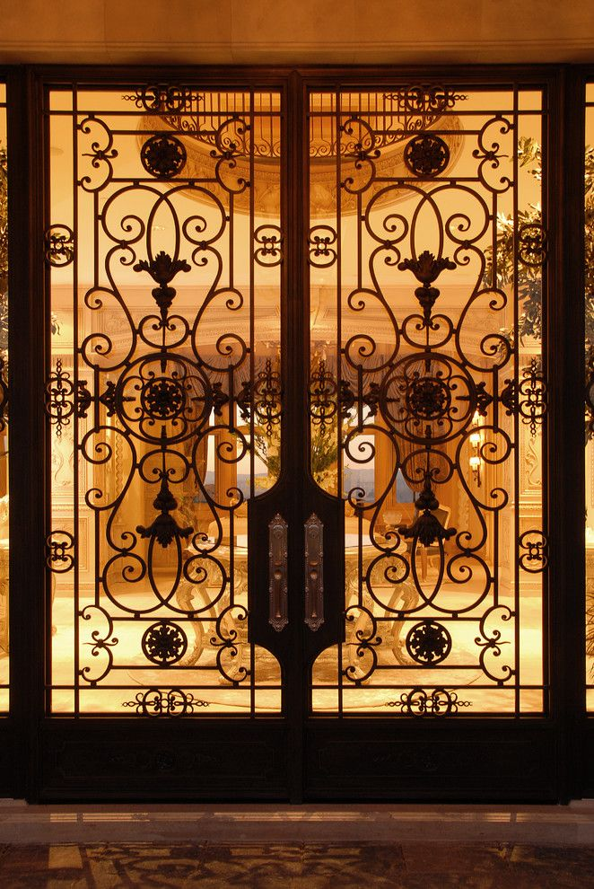 French Chateau for a Traditional Entry with a Iron Entry Doors and French Chateau by Roy Sklarin Interiors