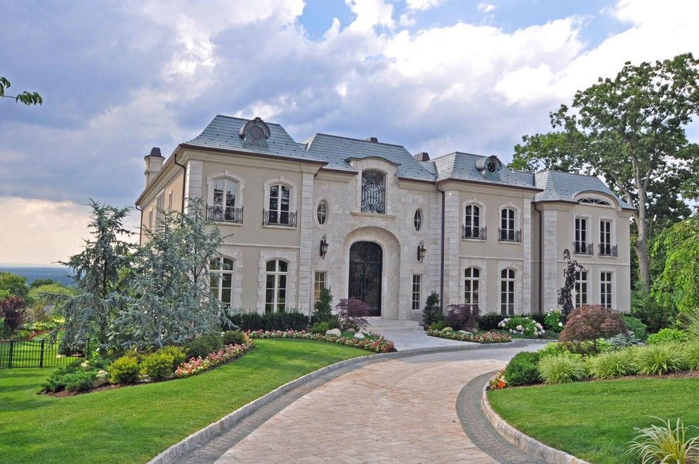 French Chateau for a Traditional Exterior with a Exposed Brick and French Chateau by Joe Commorata