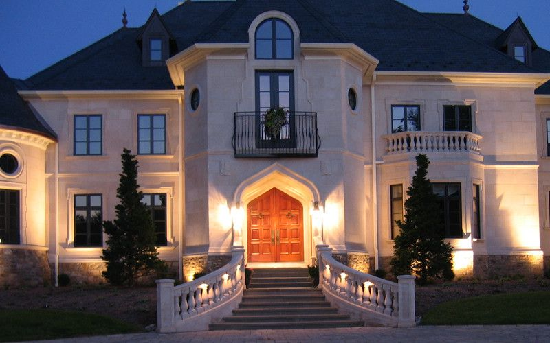 French Chateau for a Traditional Exterior with a Turrets and French Chateau Night Entry by Omnia Group Architects