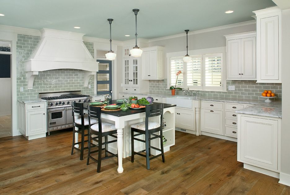 Friv4 School for a Transitional Kitchen with a Shingle Style Home and Sunset View - Cottage with Room to Grow by Visbeen Architects