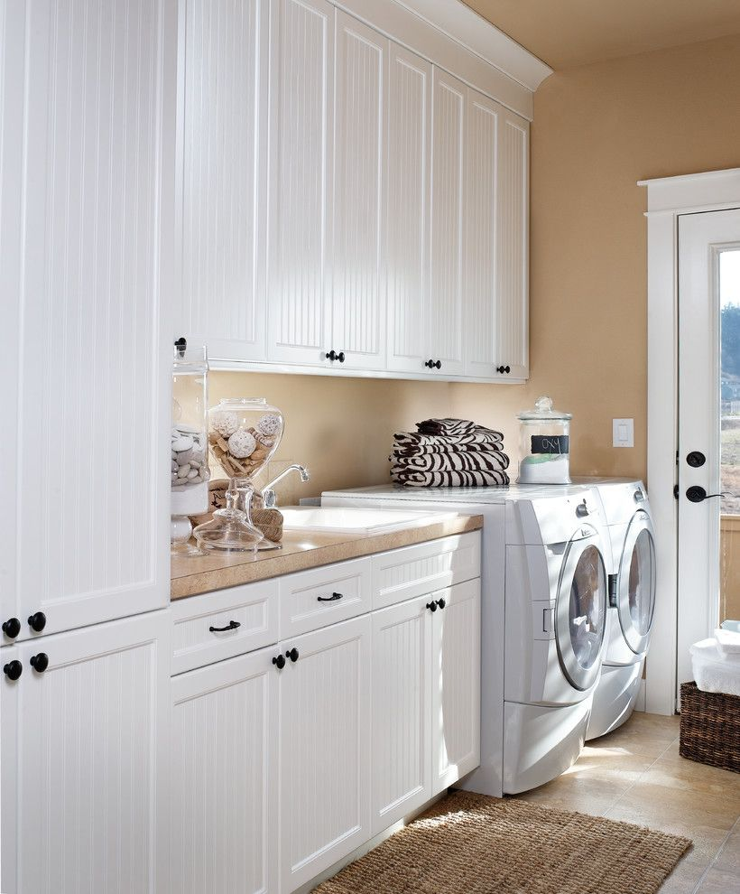 Front Load Washer Smell for a Traditional Laundry Room with a White Cabinets and Dewils Laundry Room by Dewils Custom Cabinetry
