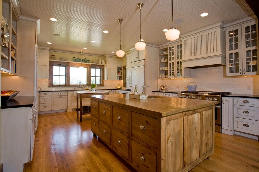 Front Range Lumber for a Farmhouse Kitchen with a Kitchen Ledge and Mill Creek Ridge Farmhouse by Murphy & Co. Design